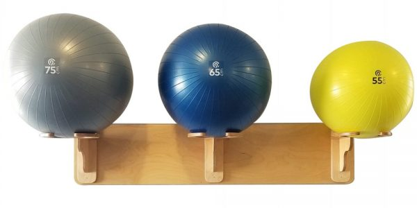 3 horizontal Spork exercise ball racks on plank