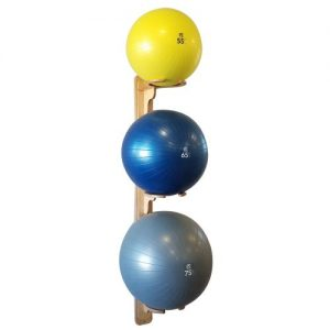 3 vertical exercise ball racks with 55cm, 65cm, and 75cm balls on plank